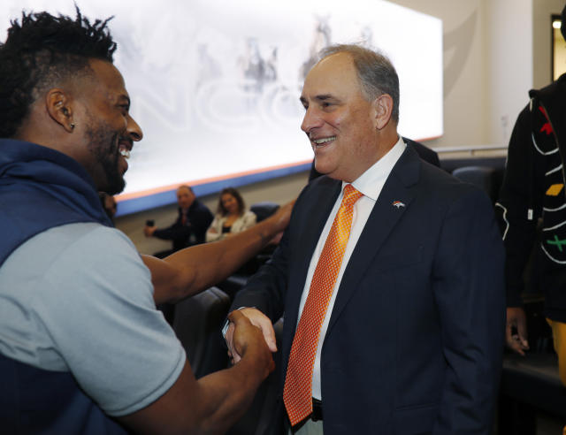 Denver Broncos new head coach Vic Fangio, right, greets wide receiver Emmanuel Sanders after a news conference at the team's headquarters Thursday, Jan. 10, 2019, in Englewood, Colo. (AP Photo/David Zalubowski)