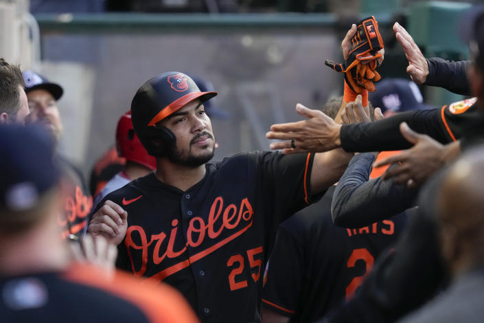 Baltimore Orioles' Anthony Santander (25) celebrates in the dugout with teammates after scoring during the third inning of a baseball game against the Los Angeles Angels Friday, July 2, 2021, in Anaheim. (AP Photo/Ashley Landis)