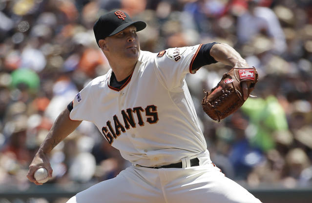 San Francisco Giants pitcher Tim Hudson throws against the Oakland Athletics during the third inning of a baseball game in San Francisco, Sunday, July 26, 2015. (AP Photo/Jeff Chiu)