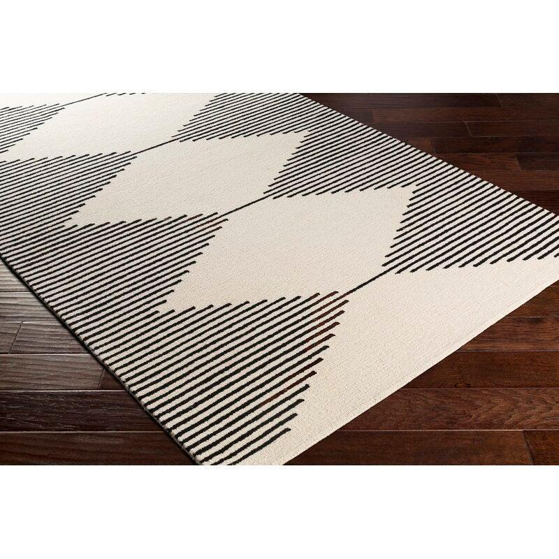 "<br><br><strong>Union Rustic</strong> Woodinville Geometric Handmade Tufted Wool Rug (2' x 3, $, available at <a href=""https://go.skimresources.com/?id=30283X879131&url=https%3A%2F%2Fwww.wayfair.com%2Frugs%2Fpdp%2Funion-rustic-woodinville-geometric-handmade-tufted-wool-blackcream-area-rug-w004051669.html%3Fpiid%3D1283482228"" rel=""nofollow noopener"" target=""_blank"" data-ylk=""slk:Wayfair"" class=""link rapid-noclick-resp"">Wayfair</a>"