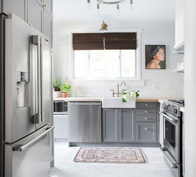 "<p>To open up the walkway and useable space in <a href=""https://www.younghouselove.com/podcast-24-chris-loves-julia/"" rel=""nofollow noopener"" target=""_blank"" data-ylk=""slk:this kitchen"" class=""link rapid-noclick-resp"">this kitchen</a>, <a href=""https://www.chrislovesjulia.com/before-and-after-a-small-pittsburgh-kitchen-gets-a-complete-makeover-in-6-days/"" rel=""nofollow noopener"" target=""_blank"" data-ylk=""slk:Chris Loves Julia"" class=""link rapid-noclick-resp"">Chris Loves Julia</a> opted for a stainless steel built-in fridge and then refreshed the walls with brighter subway tiles and gave the bottom cabinets a coat of modern blue-gray paint. Almost everything is from IKEA, and they did it all within six days. Now that's impressive. </p>"