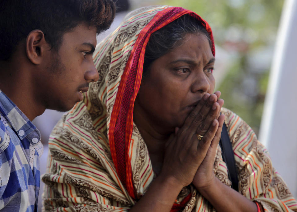 A woman reacts after identifying a body of her family member, who was killed in the Friday's plane crash, at a morgue in Karachi, Pakistan, Saturday, May 23, 2020. An aviation official says a passenger plane belonging to state-run Pakistan International Airlines carrying passengers and crew has crashed near the southern port city of Karachi. (AP Photo/Fareed Khan)