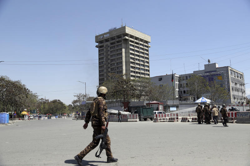 Afghan Security personnel arrive outside the Telecommunication Ministry during a gunfight with insurgents in Kabul, Afghanistan, Saturday, April 20, 2019. Afghan officials say an explosion has rocked the telecommunications ministry in the capital city of Kabul. Nasart Rahimi, a spokesman for the interior ministry, said Saturday the blast occurred during a shootout with security forces. (AP Photo/Rahmat Gul)