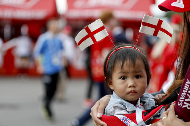 A child arrives for the semifinal match between Croatia and England at the 2018 soccer World Cup in the Luzhniki Stadium in Moscow, Russia, Wednesday, July 11, 2018. (AP Photo/Rebecca Blackwell)