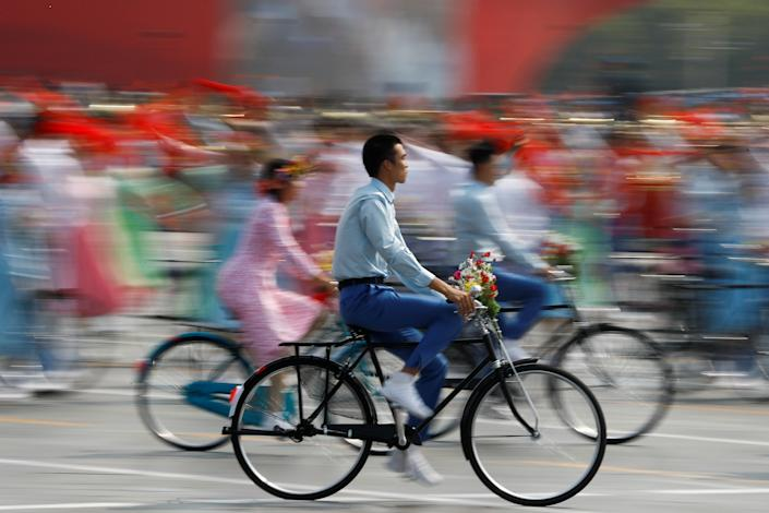 Performers ride bicycles during a parade marking the 70th founding anniversary of People's Republic of China, on its National Day in Beijing, China October 1, 2019. (Photo: Thomas Peter/Reuters)