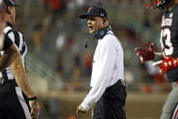Texas Tech coach Matt Wells yells out to a referee during the second half of an NCAA college football game against TCU, Saturday, Oct. 9, 2021, in Lubbock, Texas. (AP Photo/Brad Tollefson)