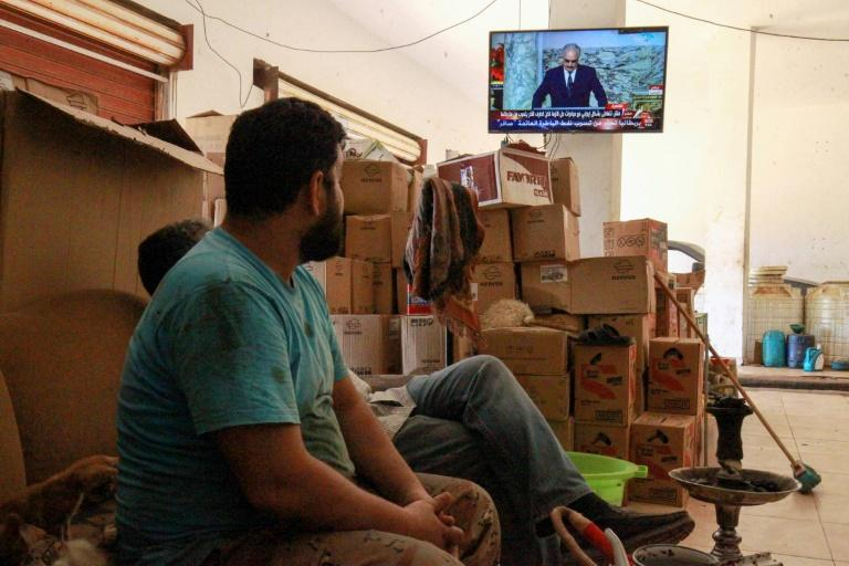 Libyans in the eastern port city of Benghazi watch a televised speech by strongman Khalifa Haftar, whose forces have lost significant ground to a UN recognised government in recent weeks (AFP Photo/Abdullah DOMA)