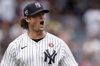 New York Yankees pitcher Gerrit Cole reacts after striking out New York Mets first baseman Pete Alonso to end the top of the third inning of the first baseball game of a doubleheader on Sunday, July 4, 2021, in New York. (AP Photo/Adam Hunger)