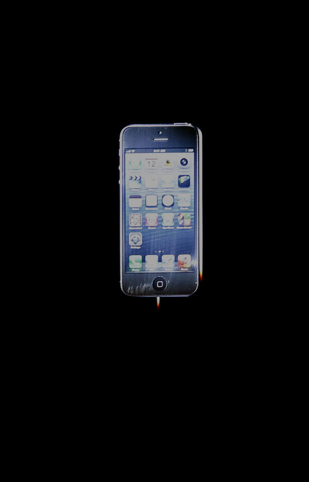 The iPhone 5 is shown during an Apple event in San Francisco, Wednesday, Sept. 12, 2012. (AP Photo/Jeff Chiu)