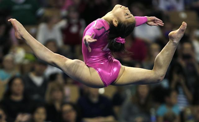 Katelyn Ohashi, of the United States, performs in the floor exercise during the American Cup gymnastics competition in Worcester, Mass., Saturday, March 2, 2013. Ohashi won the event. (AP Photo/Charles Krupa)
