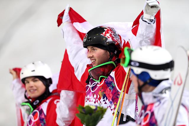 SOCHI, RUSSIA - FEBRUARY 10: Gold medalist Alex Bilodeau of Canada (C) celebrates during the flower ceremony for the Men's Moguls Finals on day three of the Sochi 2014 Winter Olympics at Rosa Khutor Extreme Park on February 10, 2014 in Sochi, Russia. (Photo by Mike Ehrmann/Getty Images)