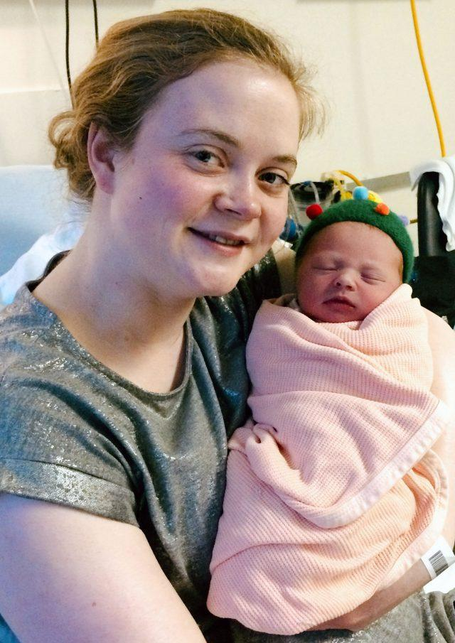 Nataleigh McGonagle with her new baby who was born at 5.39 am on Christmas Day (NHS Grampian/PA)