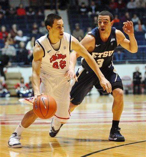 """Mississippi's Marshall Henderson (22) drives against East Tennessee State's Mario Stramaglia (3) at the C.M. """"Tad"""" Smith Coliseum in Oxford, Miss. onFriday, Dec. 14, 2012. (AP Photo/Oxford Eagle, Bruce Newman)"""
