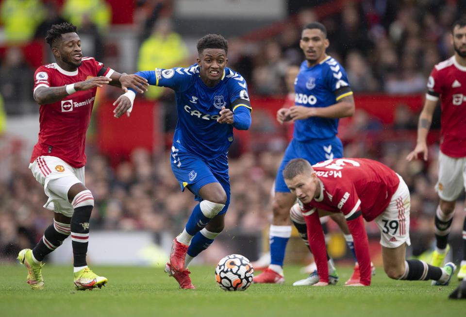 Demarai Gray of Everton (centre) and Fred of Manchester United tussle for the ball during their Premier League match at Old Trafford.