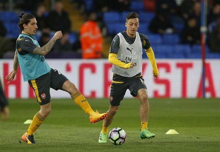 Arsenal's Mesut Ozil and Hector Bellerin warms up before the match