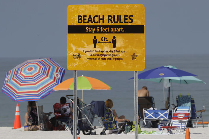 Beachgoers after Florida's Clearwater Beach officially reopened to the public on May 4. (Chris O'Meara/AP)