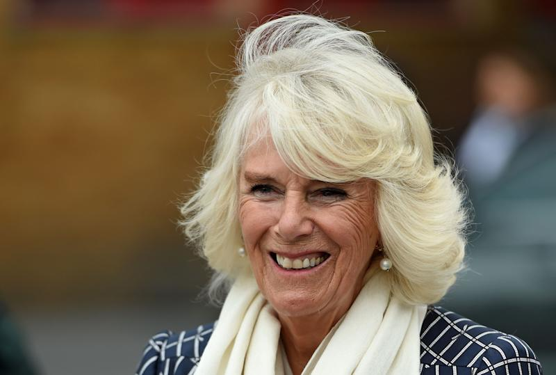 Britain's Camilla, Duchess of Cornwall reacts as she meets with firefighters, staff from Great Western Hospital, and paramedics from South Western Ambulance Service during her visit to Swindon Fire Station in Swindon, west of London on July 6, 2020. - Britain has suffered the deadliest coronavirus outbreak in Europe, reporting more than 44,000 deaths among patients who have tested positive. Infection rates have fallen significantly but experts warn the virus remains in circulation. (Photo by Eddie MULHOLLAND / POOL / AFP) (Photo by EDDIE MULHOLLAND/POOL/AFP via Getty Images)