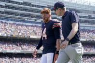 Chicago Bears quarterback Andy Dalton walks to the locker room with an unidentified trainer during the first half of an NFL football game against the Cincinnati Bengals Sunday, Sept. 19, 2021, in Chicago. (AP Photo/Nam Y. Huh)