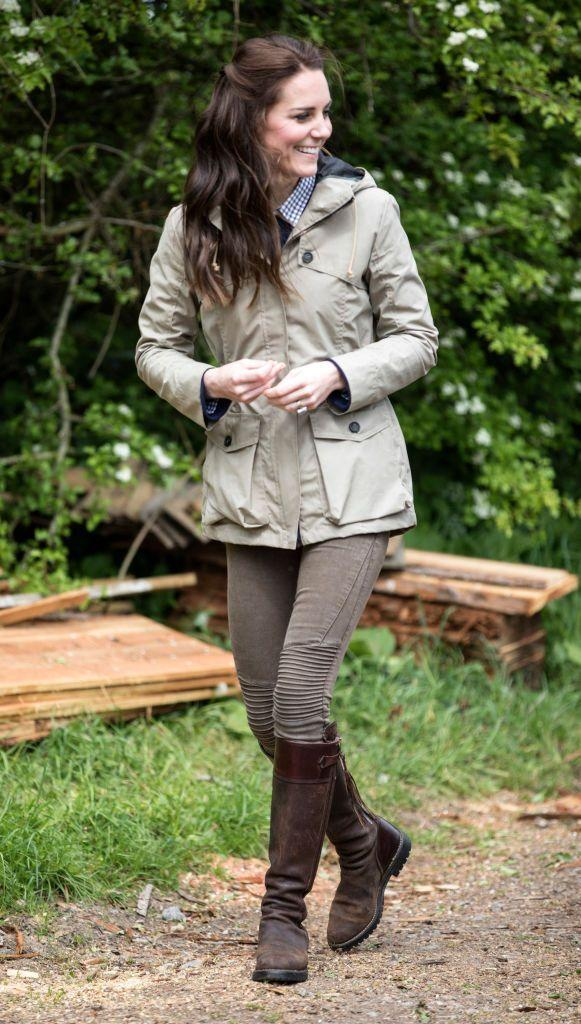 """<p>The Duchess of Cambridge dressed down <a href=""""https://www.townandcountrymag.com/leisure/a9599380/kate-middleton-farm-day-trip/"""" rel=""""nofollow noopener"""" target=""""_blank"""" data-ylk=""""slk:during her visit to a farm with &quot;Farms for Children,&quot;"""" class=""""link rapid-noclick-resp"""">during her visit to a farm with """"Farms for Children,""""</a> an organization that allows inner city kids to visit a working ranch for a week. She wore a khaki jacket from Troy London, Zara jeans, and Penelope Chilvers boots that only a royal could pull off while doing farm chores.</p>"""