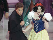 FILE-- In this March 30, 1989 file photo, actor Rob Lowe croons a tune to Snow White during the opening number for the 61st Academy Awards presentation in Los Angeles. (AP Photo/ Reed Saxon, File)