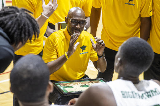 Chicago State head coach Lance Irvin coaches his team during a time out in the second half of an NCAA college basketball game against Jacksonville State at the Emerald Coast Classic in Niceville, Fla., Friday, Nov. 29, 2019. (AP Photo/Mark Wallheiser)