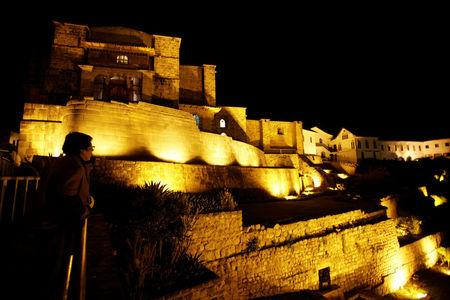 FILE PHOTO A man looks at the Coricancha Inca Temple in the city of Cuzco