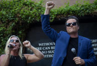 Republican Reps. Marjorie Taylor Greene and Matt Gaetz make an appearance at a rally Saturday, July 17, 2021, in Riverside, Calif. The two held a protest after a third venue in California canceled their event. Instead, they held a protest outside City Hall in Riverside, where one of the events was canceled. An Anaheim spokesman had announced the latest cancellation hours before the rally was scheduled to begin. (Cindy Yamanaka/The Orange County Register via AP)