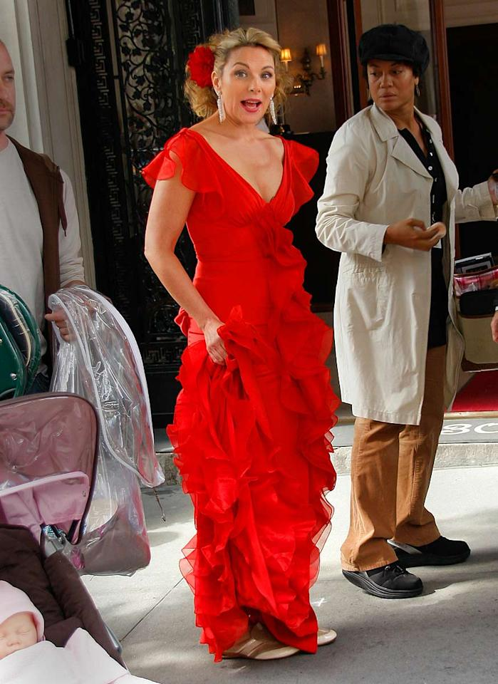 "Kim Cattrall looks more like a sexy senorita than a bridesmaid in her fiery red dress. Jackson Lee/<a href=""http://www.splashnewsonline.com/"" target=""new"">Splash News</a> - October 3, 2007"
