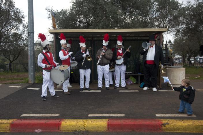 A band stands in a bus station during the second annual marathon in Jerusalem, Friday, March 16, 2012. About 15,000 runners, including 1,500 from overseas, are competing Friday, with some 1,000 competitors expecting to complete the full 42 kilometers (26.2 miles) marathon distance, and others aiming to complete shorter distances, including Mayor Nir Barkat who says he plans to run half a marathon and 77-year old Hanoch Shahar aiming for 10Km. (AP Photo/Sebastian Scheiner)