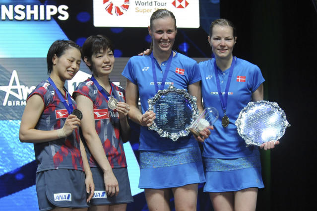Winners Denmark's Kamilla Rytter Juhl and Christinna Padersen, right, poseon the podium with second placed Japan's Yuki Fukushima, left, and Sayaka Hirota after the women's doubles final match at the All England Open Badminton tournament in Birmingham, England, Sunday March 18, 2018. (AP Photo/Rui Vieira)