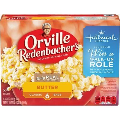 """Orville Redenbacher's® Gourmet Popping Corn, Swiss Miss® Hot Cocoa Mix, and Hallmark Channel have teamed up for the return of the """"Snack, Watch and Win"""" Sweepstakes. One grand prize winner will receive a walk-on role in an upcoming Hallmark Channel original movie taping in mid to late 2021, along with a one-year supply of Orville Redenbacher's microwave popcorn. Details can be found on specially marked packages of Orville Redenbacher's."""
