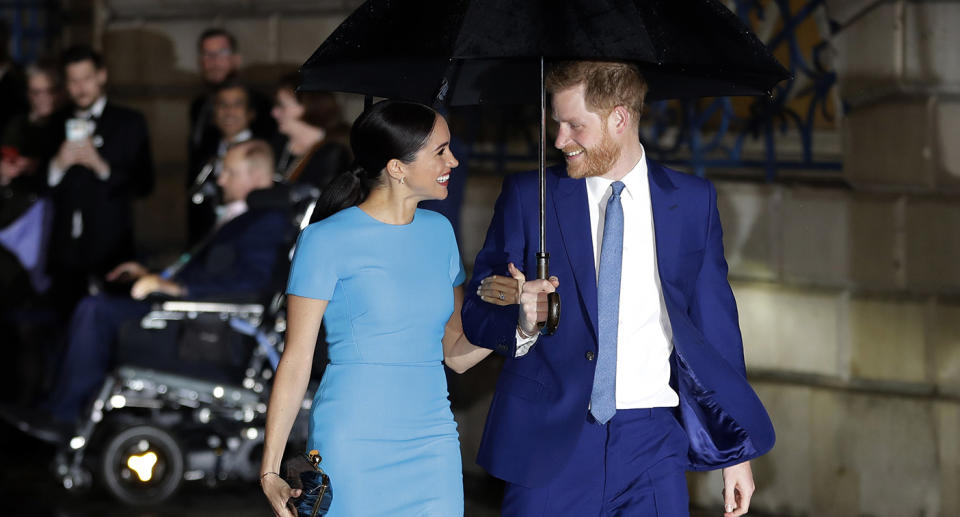 Britain's Prince Harry and Meghan walk arm-in-arm in a photo taken on Thursday, March 5, 2020.