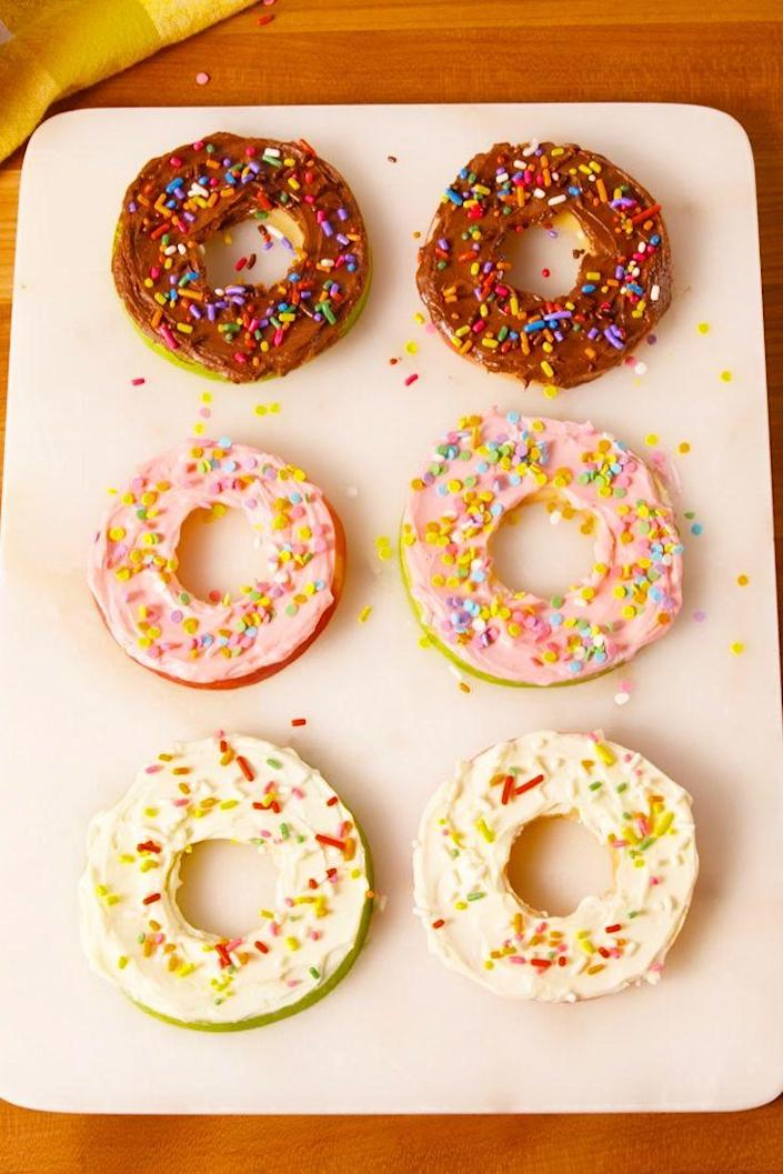 """<p>Your kiddos will freak over the sprinkles.</p><p>Get the recipe from <a href=""""https://www.delish.com/cooking/recipe-ideas/recipes/a52053/donut-apples-recipe/"""" rel=""""nofollow noopener"""" target=""""_blank"""" data-ylk=""""slk:Delish"""" class=""""link rapid-noclick-resp"""">Delish</a>.<br></p>"""
