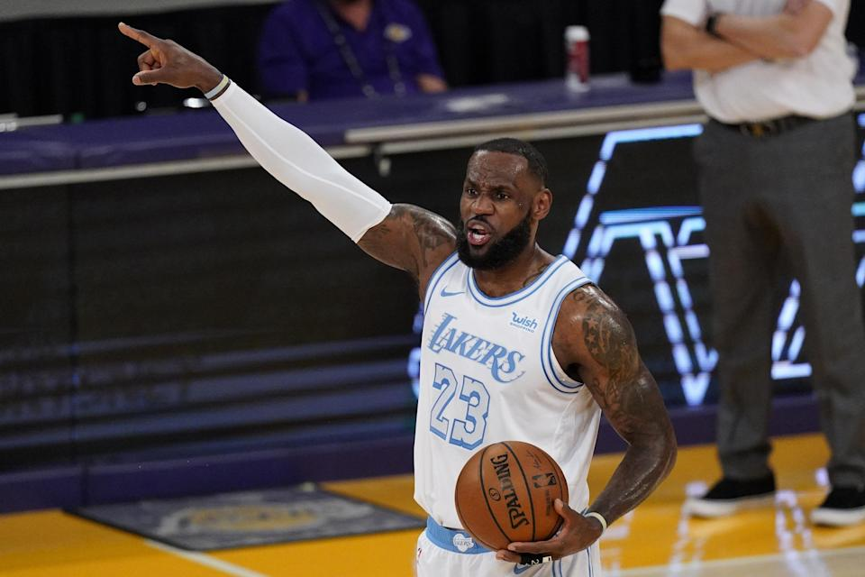 Los Angeles Lakers forward LeBron James gestures during the first half of an NBA basketball game against the Washington Wizards Monday, Feb. 22, 2021, in Los Angeles. (AP Photo/Mark J. Terrill)