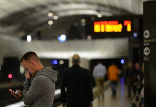 A man uses his smartphone in a metro station in Washington, DC. The Internet is set for a major upgrade in the coming week, but if all goes well, users won't even know it's happening