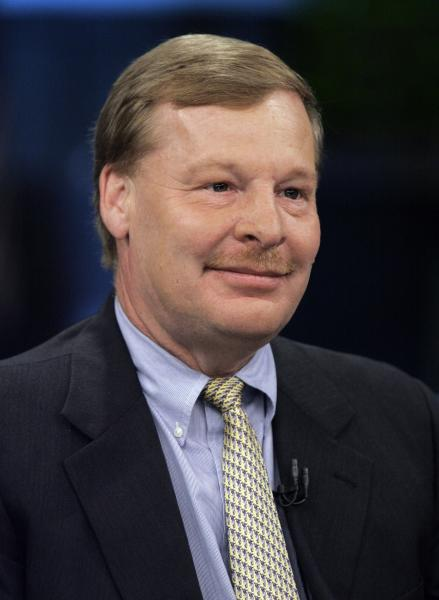 FILE - In this June 12, 2007 file photo Edward Breen, chairman and CEO of Tyco International Ltd., is interviewed at the New York Stock Exchange. Foreign executives who moved their company headquarters to Switzerland to get better tax deals for their firms may find themselves paying the price for it this weekend. A plan to crack down on excessive corporate pay packages is predicted to pass at the ballot box Sunday, March 3, 2013. (AP Photo/Richard Drew, File)