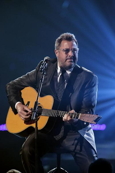 This image released by NBC Universal shows country singer Vince Gill during the Healing in the Heartland: Relief Benefit Concert at the Chesapeake Energy Arena in Oklahoma City, Okla., Wednesday, May 29,2013. Funds raised by the benefit will go to the United Way of Central Oklahoma, for recovery efforts for those affected by the May 20 tornado. (AP Photo/NBC, Brett Deering)