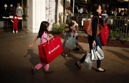 People shop at The Grove mall in Los Angeles in this November 26, 2013 file photo. REUTERS/Lucy Nicholson/Files