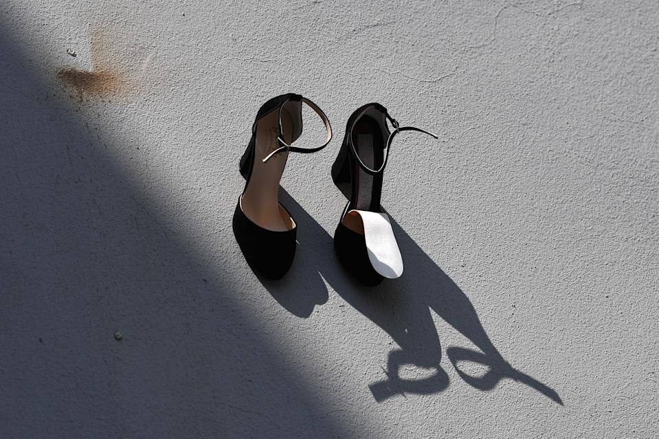 This picture taken on September 17, 2019 in Istanbul shows a part of a contemporary art installation by Turkish artist Vahit Tuna in an attempt to raise awareness on women killed by domestic violence by their partners and husbands. - Turkish artist Vahiot Tuna placed 440 pair of female shoes on the walls of a building to symbolize women killed by their partners and husbands in 2018 in Turkey. (Photo by Ozan KOSE / AFP) / RESTRICTED TO EDITORIAL USE - MANDATORY MENTION OF THE ARTIST UPON PUBLICATION - TO ILLUSTRATE THE EVENT AS SPECIFIED IN THE CAPTION        (Photo credit should read OZAN KOSE/AFP/Getty Images)