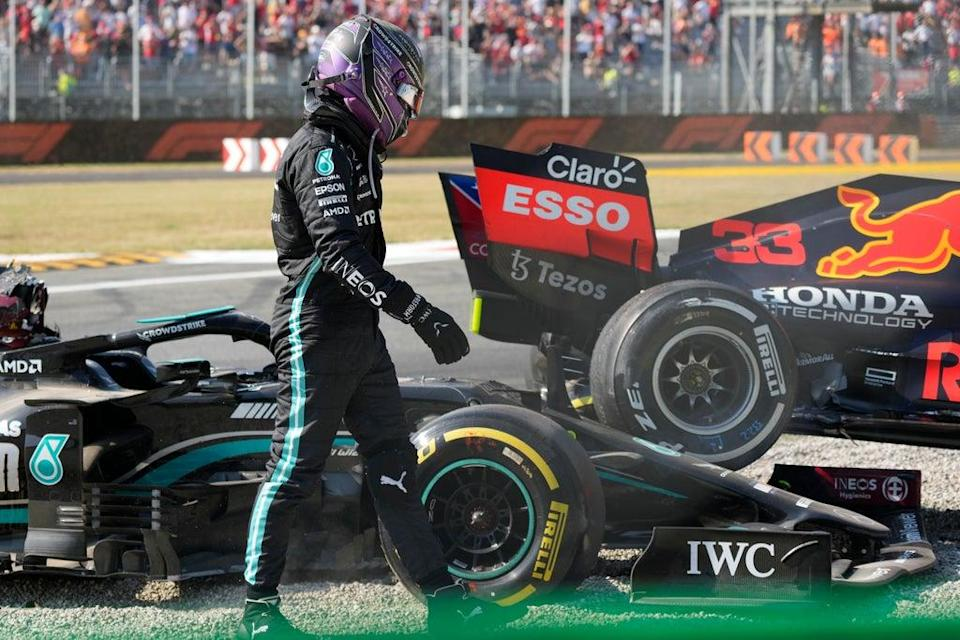 Lewis Hamilton walks away from his Mercedes after colliding with Max Verstappen (Luca Bruno/AP) (AP)