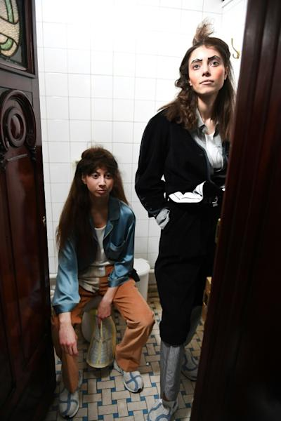 Models present creations by Sirloin during the women's Fall-Winter 2017-2018 ready-to-wear collection fashion show at the Madeleine's historical public toilets in Paris on March 3, 2017