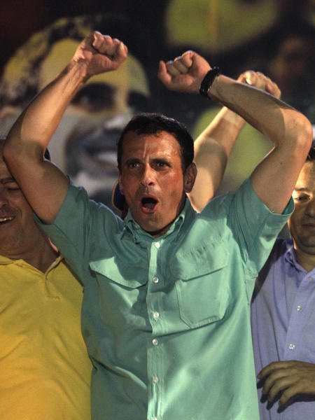 FILE - In this Sunday Feb. 12, 2012 file photo, Henrique Capriles celebrates after wining the opposition presidential primary in Caracas, Venezuela. Venezuela's President Hugo Chavez finds himself ailing as he heads into a re-election campaign against Capriles, a 39-year-old state governor who represents a younger and more energetic option, said Diego Moya-Ocampos, an analyst with the London-based consulting firm IHS Global Insight. (AP Photo/Ariana Cubillos, File)