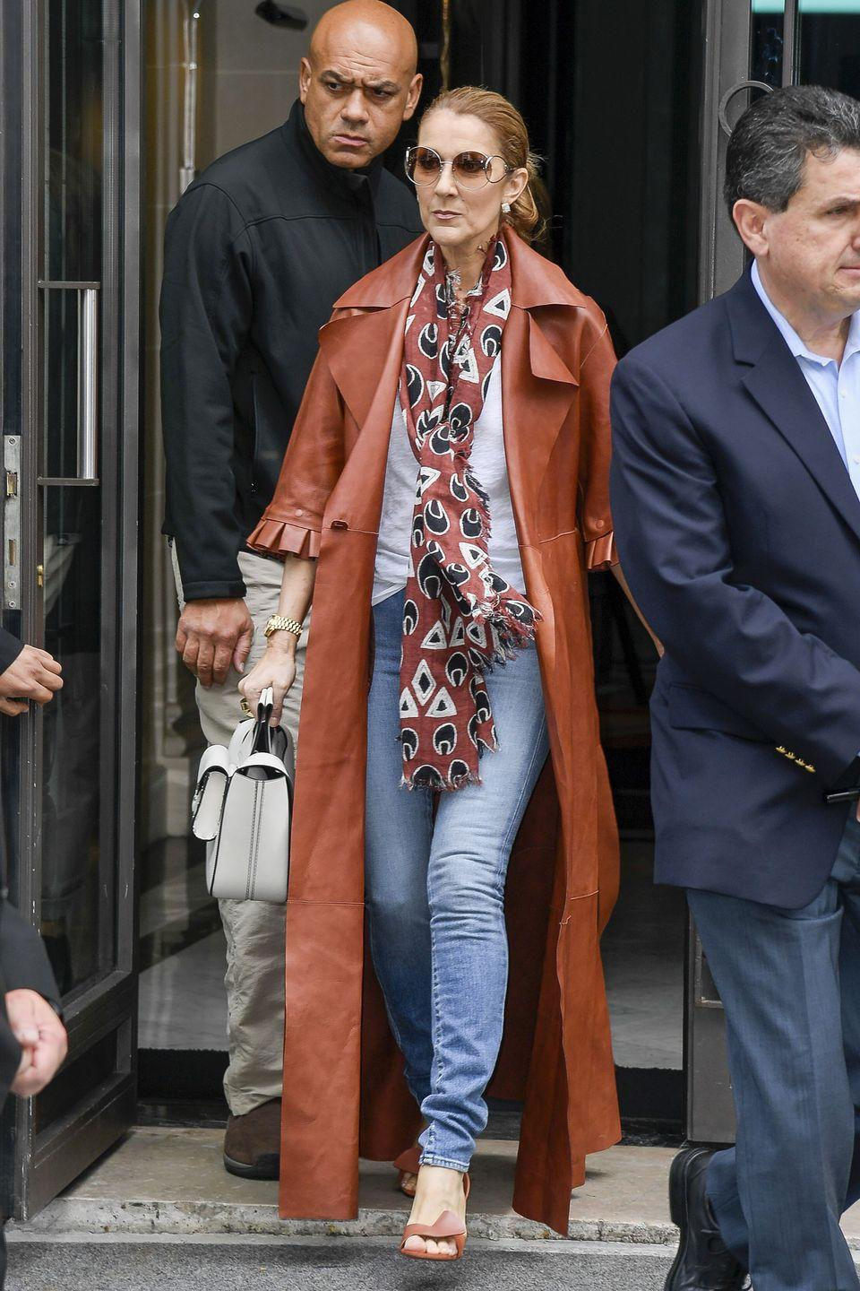 <p>In an Off-White leather trench coat, Chloé scarf, and Céline shoes and bag while walking the streets of Paris. </p>