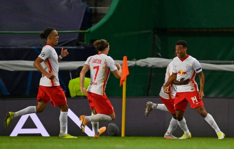 Leipzig's US midfielder Tyler Adams (R) celebrates his goal with teammates during the UEFA Champions League quarter-final football match between Leipzig and Atletico Madrid at the Jose Alvalade stadium in Lisbon on August 13, 2020. (Photo by LLUIS GENE / POOL / AFP) (Photo by LLUIS GENE/POOL/AFP via Getty Images)
