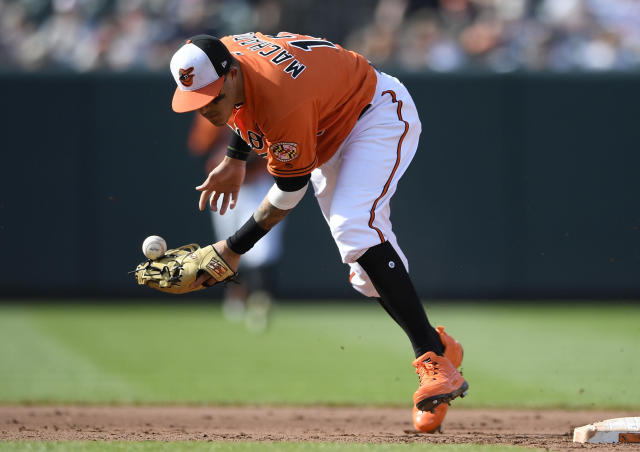 Baltimore Orioles shortstop Manny Machado cannot handle a ball hit for a single by Miami Marlins' Yadiel Rivera during the fifth inning of a baseball game, Saturday, June 16, 2018, in Baltimore. (AP Photo/Nick Wass)