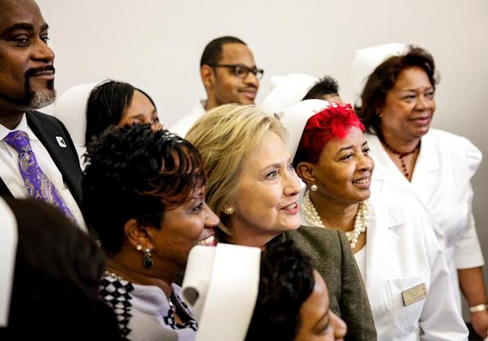 Democratic Presidental candidate Hillary Clinton has her photo taken with nurses at House of Prayer on February 7, 2016 in Flint, Michigan (AFP Photo/Sarah Rice)
