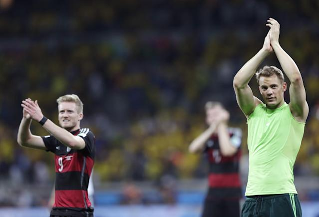 Germany's goalkeeper Manuel Neuer, right, and Andre Schuerrle react after the World Cup semifinal soccer match between Brazil and Germany at the Mineirao Stadium in Belo Horizonte, Brazil, Tuesday, July 8, 2014. Germany won the match 7-1. (AP Photo/Matthias Schrader)
