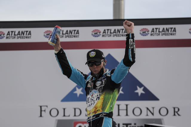 Kevin Harvick (4) celebrates after winning a NASCAR Cup Series auto race at Atlanta Motor Speedway, Sunday, June 7, 2020, in Hampton, Ga. (AP Photo/Brynn Anderson)