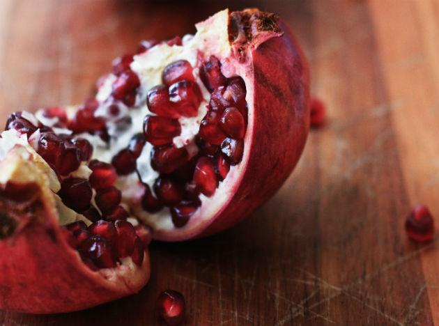 <b>Pomegranate</b>: This tasty treat helps your body fight conditions like cancer and Alzheimer's. It is also a rich source of antioxidants. Pomegranate protects your arteries, lowers cholesterol and lowers blood pressure. Do we really need to say more?