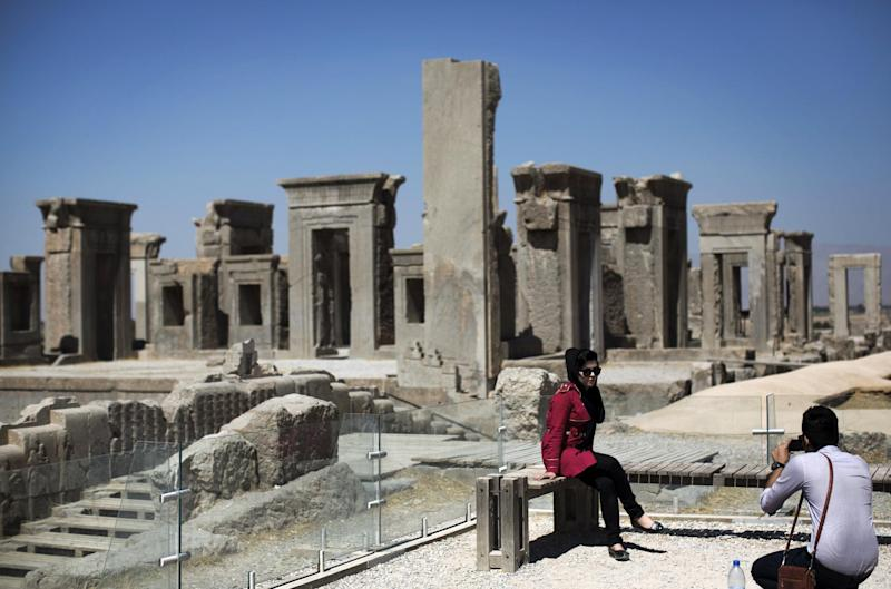 An Iranian woman poses for a photo at the ruins of Persepolis near Shiraz in southern Iran on September 26, 2014 (AFP Photo/Behrouz Mehri)